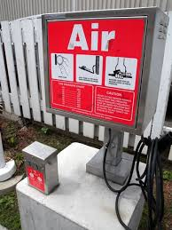 tire inflator gas station. pump w/button underneath tire inflator gas station t