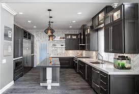 grey kitchen cabinets with dark floors