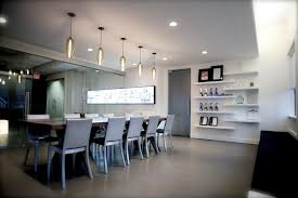 our pharos pendant lights installed over the boardroom table of the gaile guevara designed noise digital offices in vancouver bc lights provided by