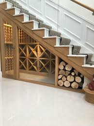 luxury under stairs wine cellar in modern private home with a glass frontmodern wine cellar