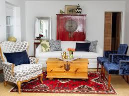white living room with blue tufted velvet chairs