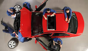 technicians working on vehicle