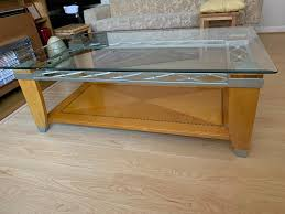 glass and solid wooden coffee table