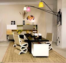 f simple home office design with rectangular high gloss black office table also curved fold broken white office chairs under white pink yellow wall lamp black gloss rectangle home office desk