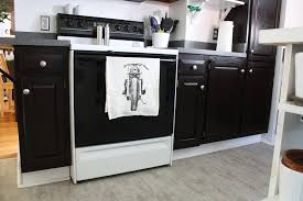 dark stained kitchen cabinets. Kitchen Cabinets, Refinished With Dark Brown Stain And Adorned A New Tea Towel. Stained Cabinets