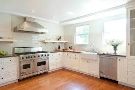 white kitchen with cream subway backsplash tiles