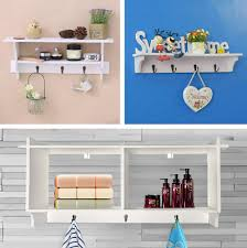 white wooden floating coat rack wall