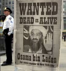 photos of and the days after a police officer stands near a wanted poster for the saudi born militant