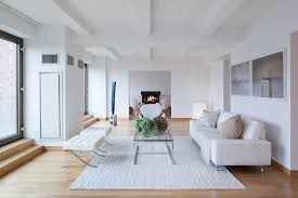 white living room rug. Modern Living Room Idea With White Sofa Decorative Pillows A Pair Of Ottomans Metal Rug .