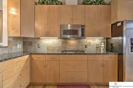 modern kitchen with new caledonia granite countertops