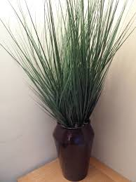 uk gardens large artificial green potted grass plant in a planter pot for house office