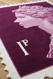 used as a conventional rug or hung on the wall for an alternative look the queen s head stamp rug is the ultimate majestic design statement