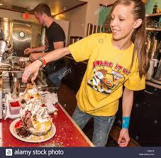Ice Cream Server Woman Server Creates One Of The Famous Huge Ice Cream Sundaes At