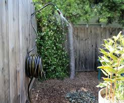a simple solar heated hose system with an upcycled can as the shower head