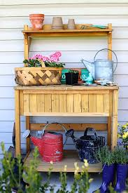 outdoor potting bench with storage can double as a serving station for summer entertaining