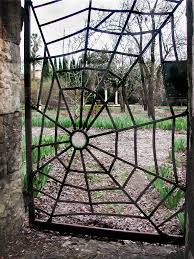we drove past this amazing spider web iron gate near a winery in st helena ca