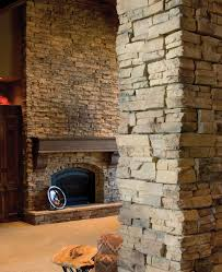stone veneer panels wall and pole with fireplace for family room ideas