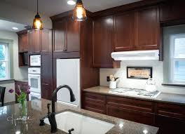 pictures of white kitchen cabinets with white appliances dark oak cabinets with white and white appliances