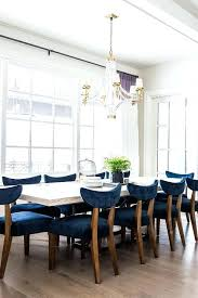 white wood dining table with blue velvet chairs crushed legs
