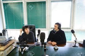 office radios. Office Radios. Girl And Boy Workers Radios Radio Broadcast Recording Headphones Sitting In Chair 5