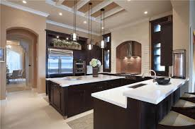 u shape kitchen with birch cabinetry and white countertops