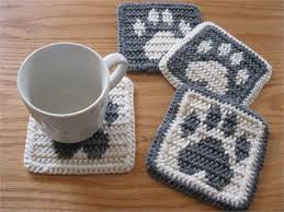grey and white paw prints crochet pet paw print decor mug rug
