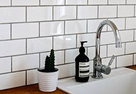 How To Clean Grout Naturally  White Subway Tile With Gray Grout Over Kitchen Sink