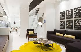 black and white living room design with yellow rug