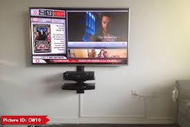 55 tv mounted over fireplace denon sound bar installed to the tv using sound bar brackets hdmi cable was pre wired during construction from fireplace to