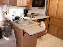 Need to add the counter top extension to my camp trailer.