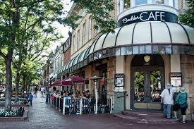 pearl street mall framed by beautifully mainned historic buildings and flower beds is the