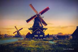 public domain photo of two windmills in holland in the late nineteenth century that was altered with the topaz dejpeg plug in then the topaz denoise