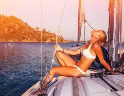Harbor Lights Tanning Sexy Woman Tanning On Yacht Enjoying Warm Sunlight Seductive