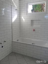 white floor tile with light grey grout designs