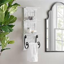 white beadboard shelves with towel bar