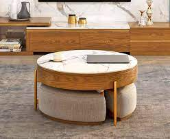 Get it as soon as wed,. This Amazing Rising Coffee Table Has 3 Integrated Ottomans That Hide Underneath It