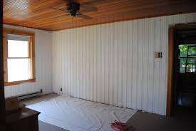 Simple White Vertical Wood Paneling Combined with Grey Flooring and Wood  Ceiling
