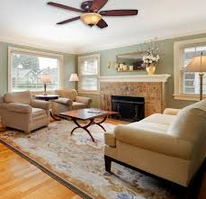 gorgeous ceiling fans for low ceilings and nice fireplace with wood laminate floor