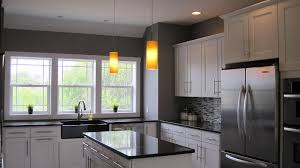 The kitchen is very open from the dining room to allow for easy # White  Kitchen Cabinets Gray Walls
