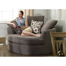 Perfect in corners, this oversized round nest chair features ample  cushions, two distinctive fabric