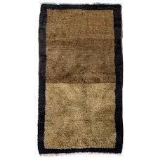 minimalist anatolian tulu rug made of natural undyed wool
