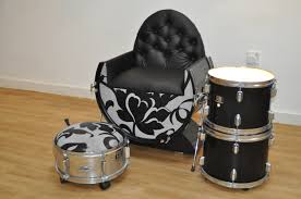 view in gallery drums repurposed as a chair and ottoman