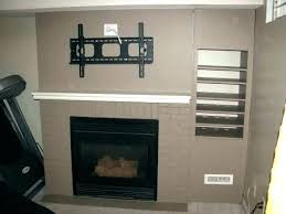 mount tv on brick fireplace hide wires how to mount a on a brick fireplace above