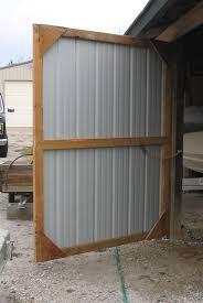 out of sight swinging barn door double shed doors with how barn door handles panel blinds