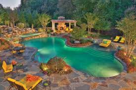 luxury backyard pool designs. Brilliant Pool Luxurious Pool Design With Stone Fireplace Backyard Swimming Pool Ideas In Luxury Designs