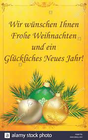 Classic biglietto di auguri per il Natale e il nuovo anno. Il messaggio ( Buon Natale e Felice Anno Nuovo) è scritto in tedesco Foto stock - Alamy