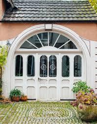 Elegant front doors Metal Large Elegant Front Door Of Home With Vintage Cobblestones And Green Flowers Outside Stock Photo Digitalverseorg Large Elegant Front Door Of Home With Vintage Cobblestones Stock