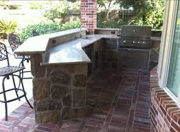 outdoor kitchen with angled flagstone bar