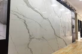 this stunning feature wall has been created using large 2 4m x 1 2m calacatta borghini white