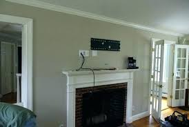 tv mounted above fireplace installation above fireplace mounted over fireplace ideas wall mount over fireplace hiding